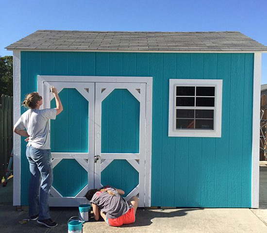 Couple painting their shed